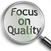 "The image shows a magnifying glass on the words ""Focus on Quality."""