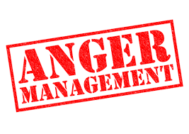 """The image displays a red sign on a white background stating """"Anger Management"""" indicating that anger can be managed."""