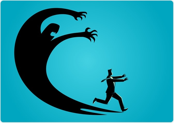 Image of a cartoon man running from an over-sized and ominous shadow figure chasing him.