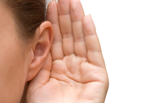 Image of a hand cupping an ear to listen.