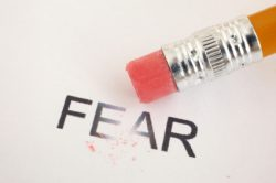 "Image of a pencil eraser erasing the word ""fear"""