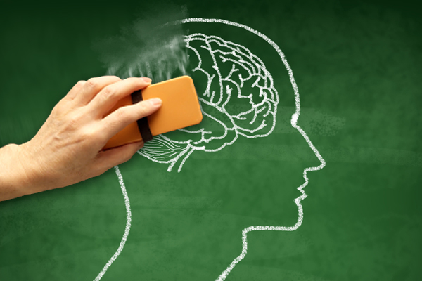 Image of a chalk drawing of a brain being erased