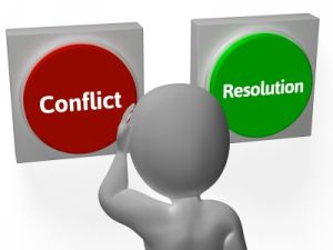 """Image of a cartoon person in front of two buttons. One says """"conflict."""" The other says """"resolution."""""""