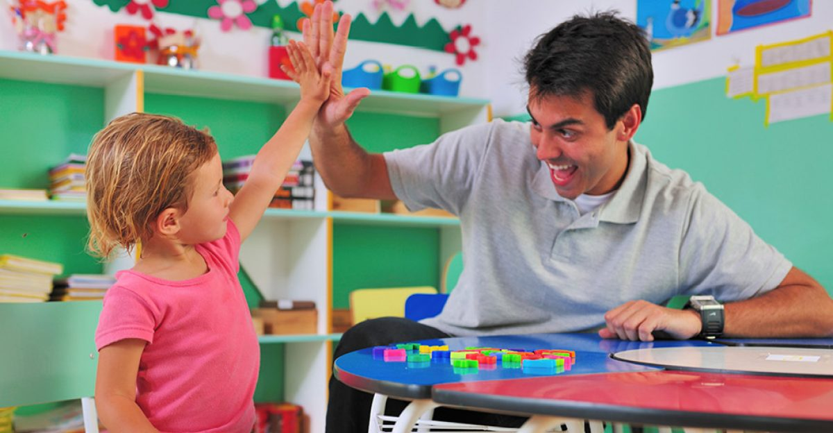 Image of a teacher and student high-fiving